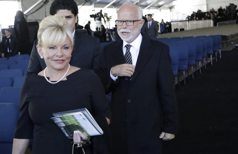 FILE - In this March 2, 2018 file photo, Televangelist Jim Bakker, right, walks with his wife Lori Beth Graham after a funeral service at the Billy Graham Library for the Rev. Billy Graham, in Charlotte, N.C. (AP Photo/Chuck Burton File)