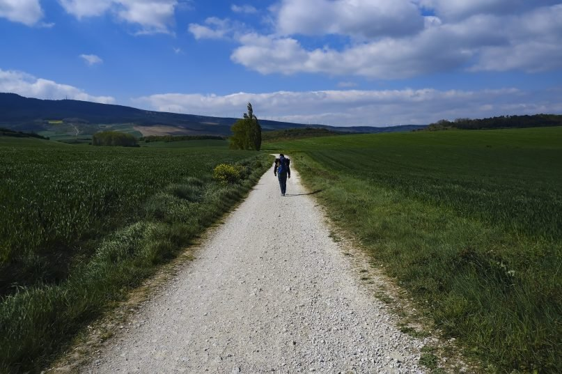 Martim Thomas, 41, from Switzerland, walks along a path during a stage of