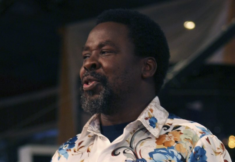 FILE - In this Sunday, Sept. 15, 2013 file photo, T.B. Joshua conducts a service at the Synagogue, Church of All Nations, in Lagos Nigeria. One of Africa's most popular televangelists, T.B. Joshua, has died, according to his church. He was 57. The Nigerian-born pastor was founder of the mega church, Synagogue Church Of All Nations (SCOAN) which also runs the Emmanuel Television Station in Lagos, Nigeria. The church announced his death in a statement Sunday, June 6, 2021. Joshua was noted for making predictions and for his claims to cure various ailments and to make people prosper through miracles. (AP Photo/Carley Petesch, File)