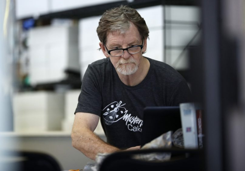 In this June 4, 2018, file photo, baker Jack Phillips, owner of Masterpiece Cakeshop, manages his shop in Lakewood, Colorado. Phillips, the Colorado baker who won a partial victory at the U.S. Supreme Court in 2018 for refusing to make a wedding cake for a same-sex couple, violated the state's anti-discrimination law by refusing to make a birthday cake for a transgender woman, Denver District Judge A. Bruce Jones ruled June 15, 2021. The group representing Phillips, Alliance Defending Freedom, said June 16 that it would appeal the ruling, which ordered him to pay a $500 fine.  (AP Photo/David Zalubowski, File)