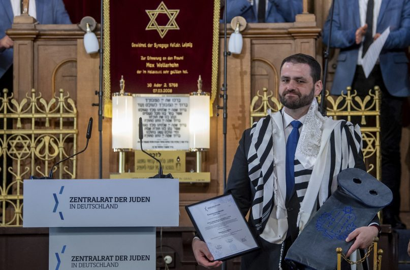 Zsolt Balla, State Rabbi of Saxony, stands in the synagogue in Leipzig, Germany, Monday June 21, 2021, after his induction into the office of Military Rabbi of the Armed Forces. The German military got its first rabbi in over a century on Monday, with the inauguration to the post of Hungarian-born Zsolt Balla at a synagogue in Leipzig. (Hendrik Schmidt/dpa via AP)