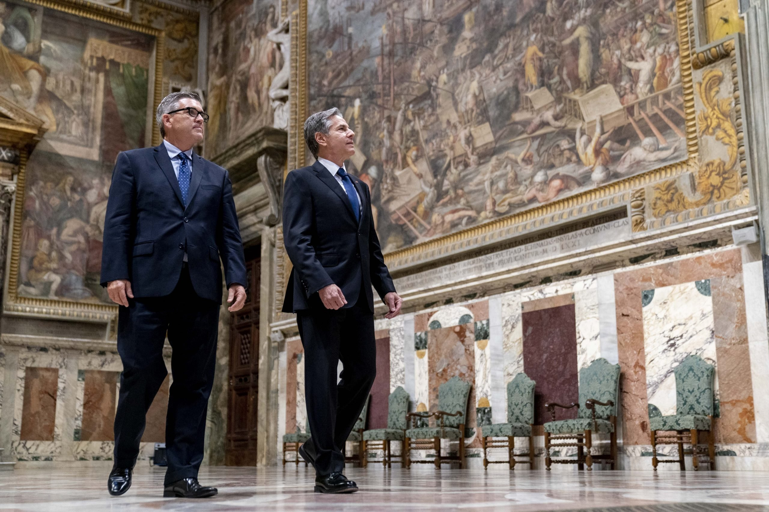 Secretary of State Antony Blinken, right, accompanied by Chargé d'Affaires of the U.S. Embassy to the Holy See Patrick Connell, left, gets a tour of the Sala Regia at the Vatican in Rome, Monday, June 28, 2021. Blinken is on a weeklong trip in Europe traveling to Germany, France and Italy. (AP Photo/Andrew Harnik, Pool)