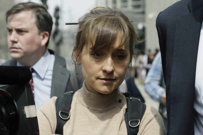 FILE - In this Monday, April 8, 2019, file photo, actress Allison Mack leaves Brooklyn federal court in New York. Mack, who played a key role in a scandal-ridden, cult-like upstate New York group, is facing sentencing Wednesday, June 30, 2021, after pleading guilty to charges she manipulated women into becoming sex slaves for the group's spiritual leader. (AP Photo/Mark Lennihan, File)