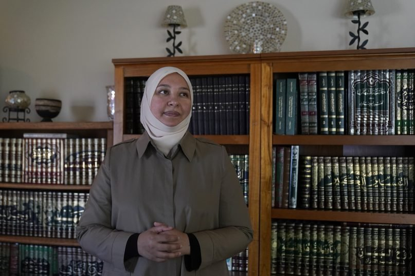 Dr. Rania Awaad stands for a portrait at her home in Union City, Calif., Wednesday, June 23, 2021. Awaad and some other Muslim mental health professionals in the United States, along with some faith leaders and activists, are working to raise awareness about mental illness and suicide prevention and to provide Islamically and culturally sensitive guidance. (AP Photo/Jeff Chiu)