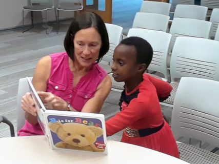 Volunteer tutor Linda Meadows, left, helps refugee child, Solange, with English at Fifth Reformed Church in Grand Rapids, Michigan. Photo courtesy of David Lubbers