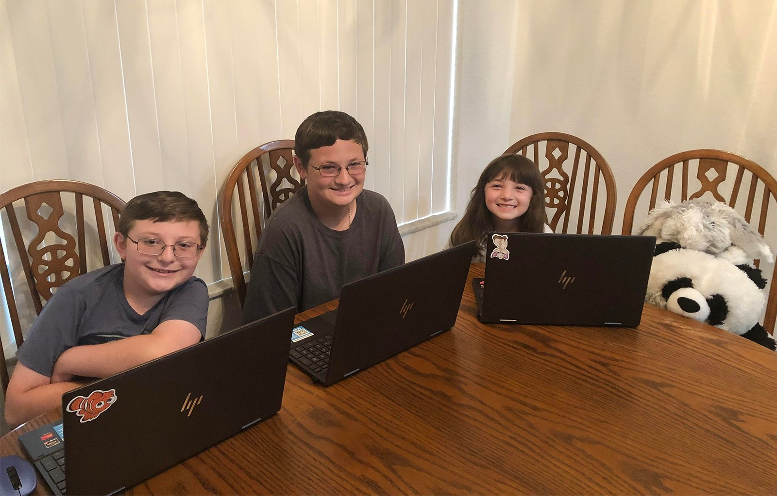 The Digiuseppi siblings Charlie, 11, from left, Anthony 14, and Abagail, 8; attend school virtually from their home in Fort Pierce, Florida. Photo courtesy of Lola Digiuseppi