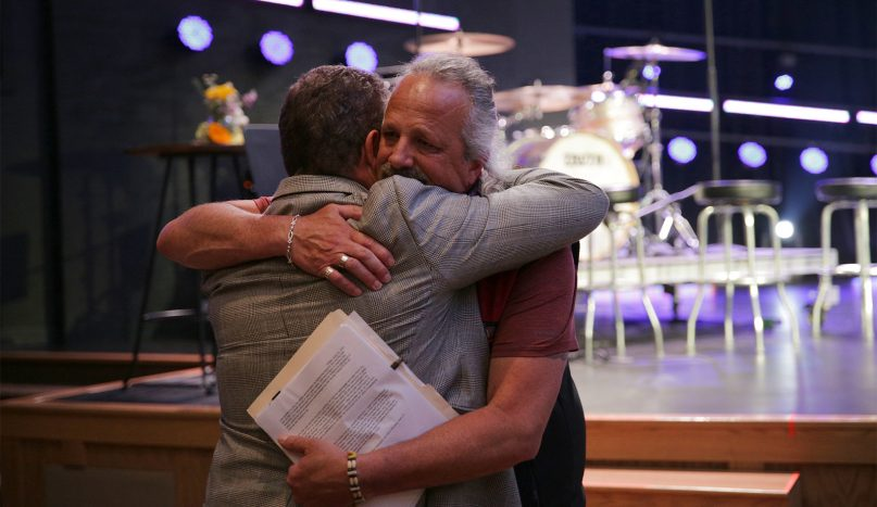 The Rev. TJ Smith, right, president of the Indigenous Ministers Association, and John Wenrich, president of the Evangelical Covenant Church, embrace after delegates vote to approve the Resolution to Repudiate the Doctrine of Discovery, during the 135th annual meeting of the Evangelical Covenant Church, June 25, 2021. Photo by Irvin Segura/Evangelical Covenant Church