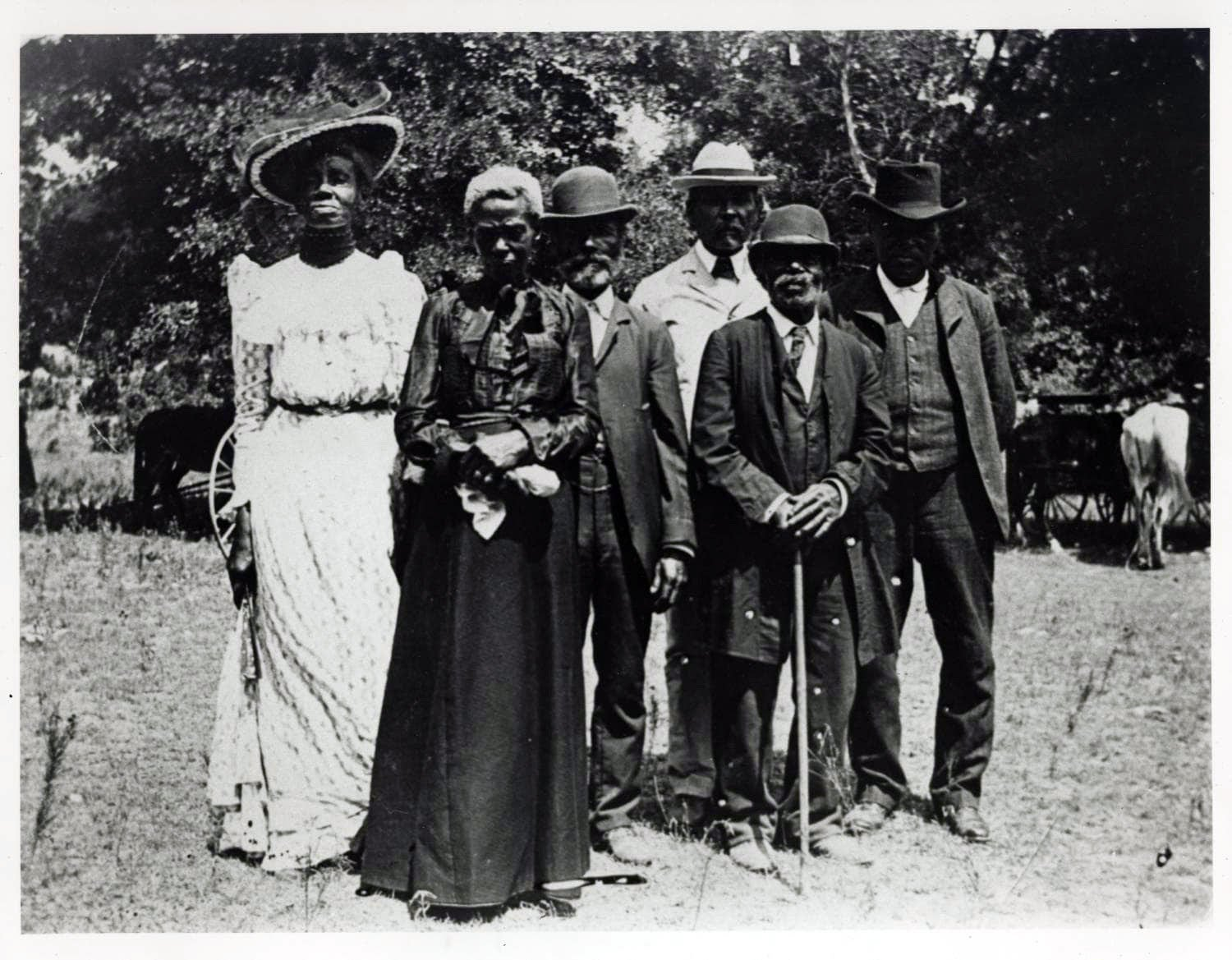 """A group of people celebrate Emancipation Day on June 19, 1900, held in """"East Woods"""" on East 24th Street in Austin, Texas. Photo courtesy of Mrs. Charles Stephenson (Grace Murray) via the Austin History Center, Austin Public Library/Creative Commons"""