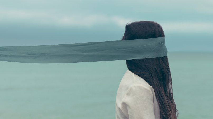 A female is covered with a blindfold. Photo by Oscar Keys/Unsplash/Creative Commons