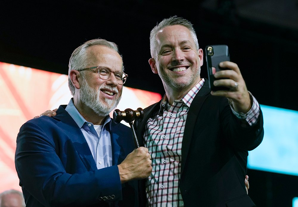 Newly elected Southern Baptist Convention president Ed Litton, left, and outgoing president J.D. Greear take a selfie after Greear pounded the gavel for the last time June 16, 2021, to close the SBC Annual Meeting. Litton will open the 2022 SBC Annual Meeting in Anaheim, California, with the pound of the gavel. Photo by Robin Jackson/Baptist Press