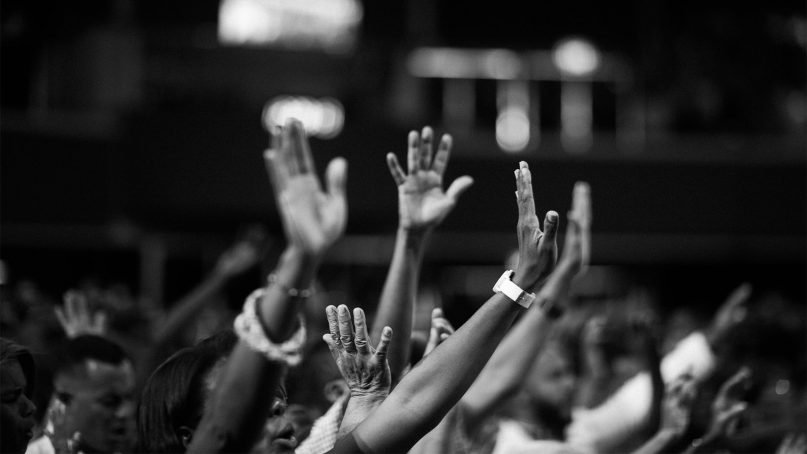 Hands raised in worship. Stock photo