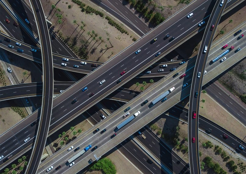 Vehicles travel along multiple layers of overpasses in Phoenix. Photo by Jared Murray/Unsplash/Creative Commons