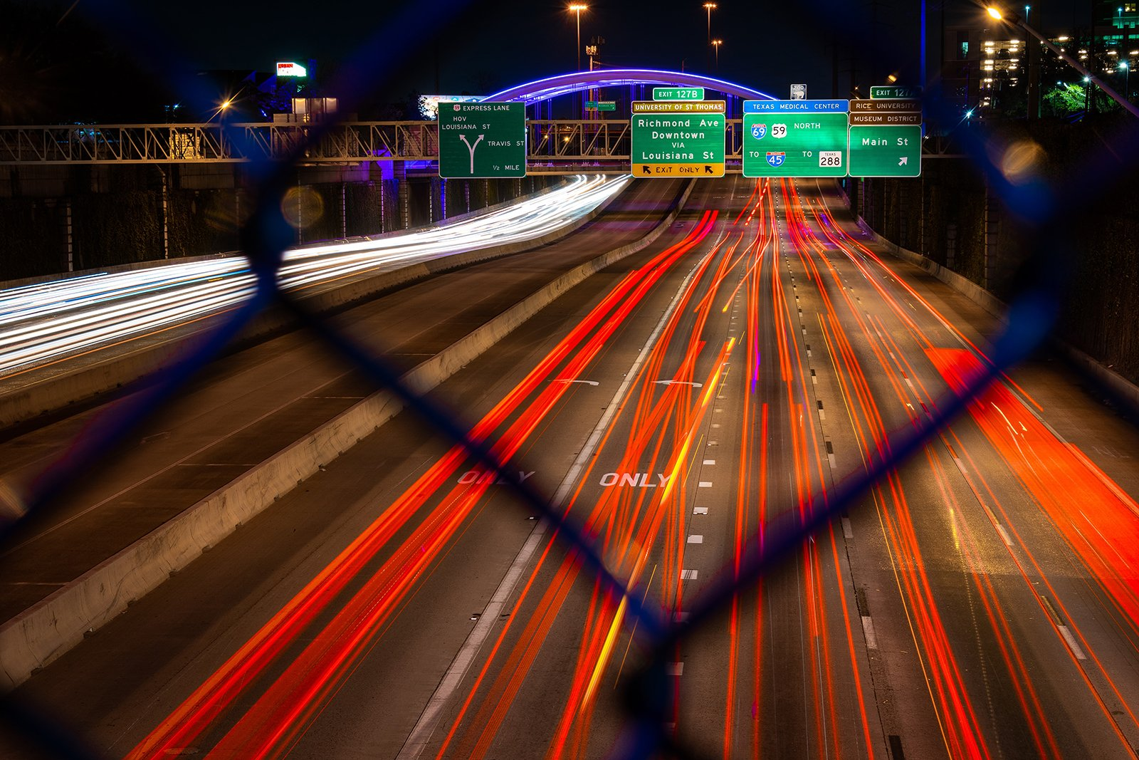 A photo with a slow shutter speed shows blurred vehicle lights in Houston, Texas. Photo by Manuel Velasquez/Unsplash/Creative Commons