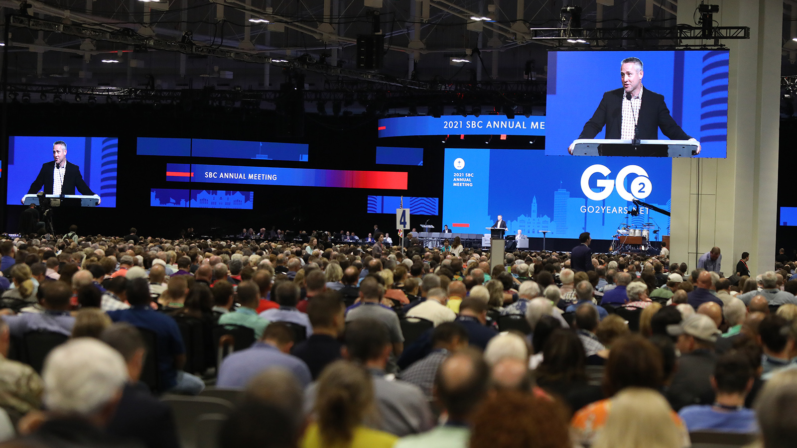 Southern Baptist Convention President J.D. Greear is projected on screens around the Music City Center while addressing the annual meeting, Wednesday, June 16, 2021, in Nashville. RNS photo by Kit Doyle