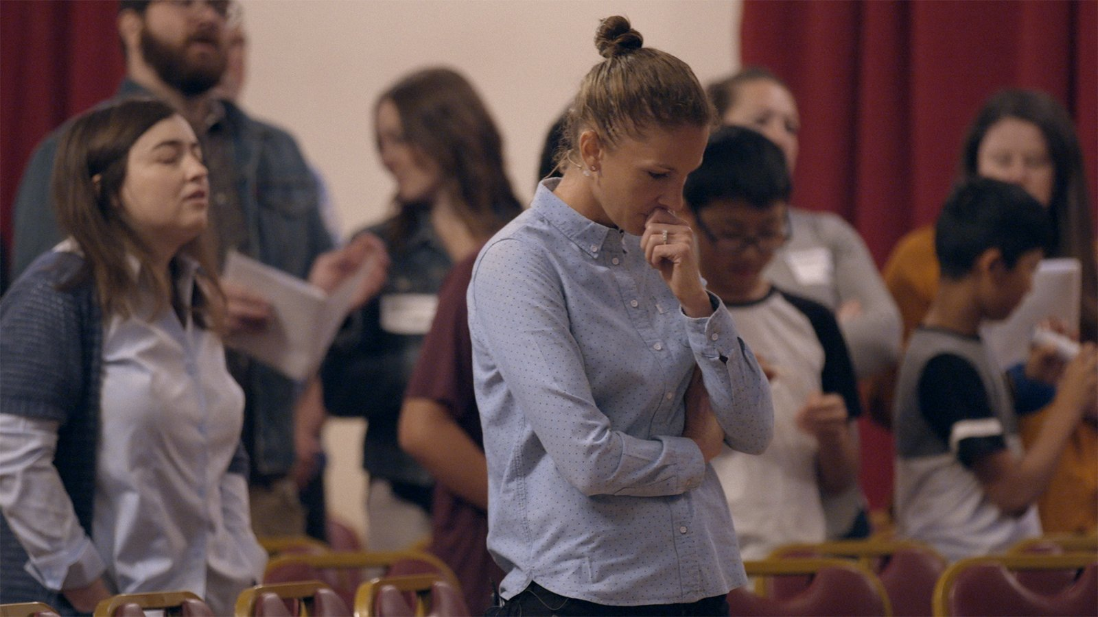 """Conversion therapy survivor Julie Rodgers at church in """"Pray Away,"""" directed by Kristine Stolakis. Image courtesy of Multitude Films"""