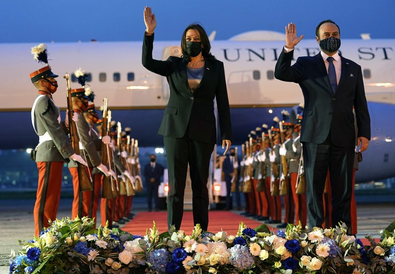 Vice President Kamala Harris and Guatemala's Minister of Foreign Affairs Pedro Brolo wave at her arrival ceremony in Guatemala City on June 6, 2021, at Guatemalan Air Force Central Command. (AP Photo/Jacquelyn Martin)