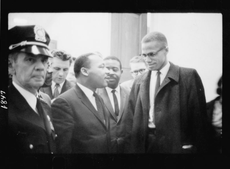 The Rev. Martin Luther King Jr., center left, and Malcolm X speak after King's press conference at the U.S. Capitol about the Senate debate on the Civil Rights Act of 1964. Photo by Marion S. Trikosko/Library of Congress/Creative Commons
