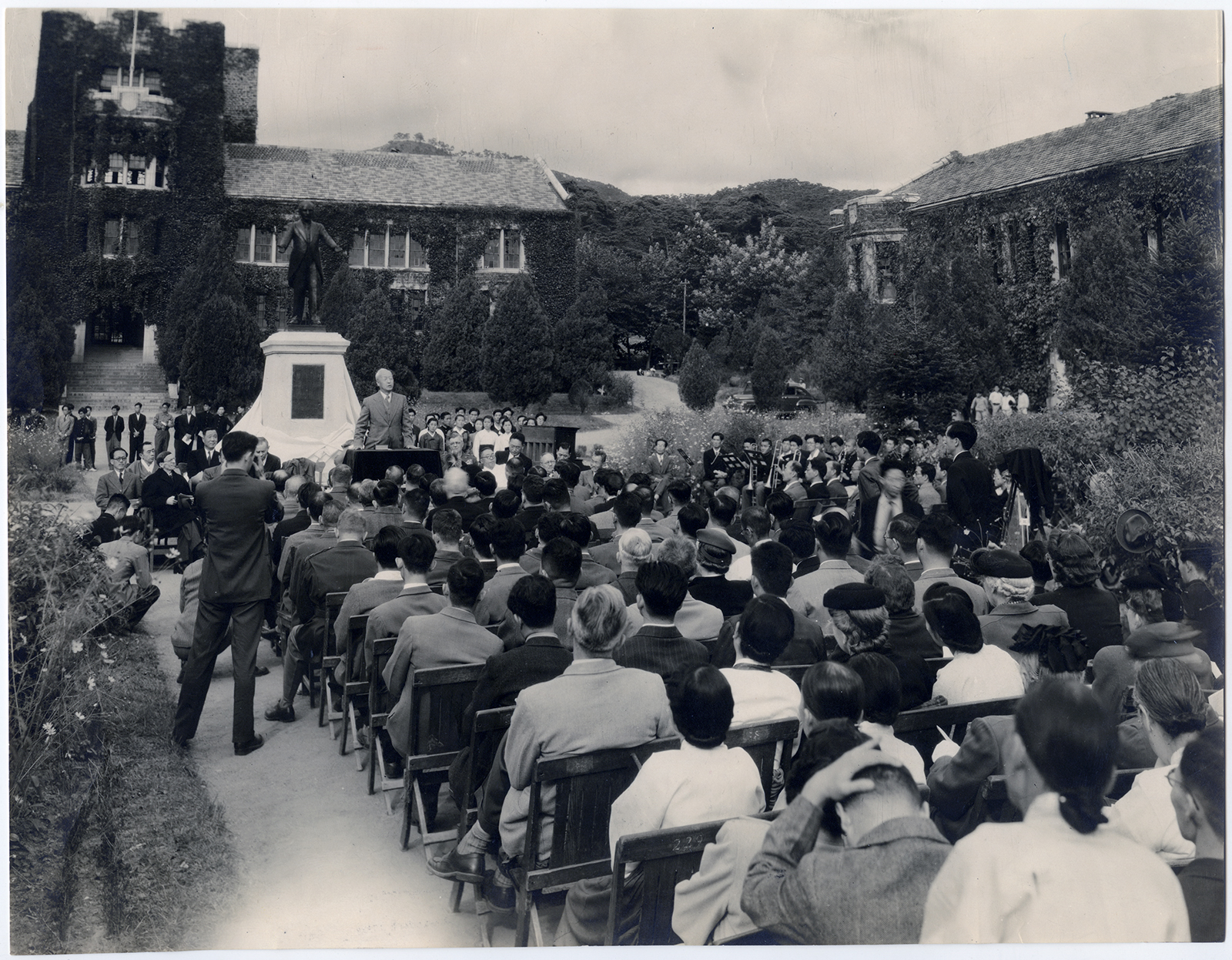 A statue of the late Dr. Horace Grant Underwood, the first Protestant missionary to Korea and founder of Chosen Christian College, is unveiled on the college grounds in Seoul, South Korea, circa October 1955. Speaking from the podium in front of the statue is Dr. Syngman Rhee, the first president of South Korea.  RNS archive photo