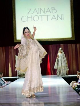 """Sitara Attaie, an advocate of law enforcement careers for Muslim girls and an actor in the show """"Homeland,"""" participates in a 2018 fashion show in Long Beach, California. Photo by FaisalPhotographer.com"""