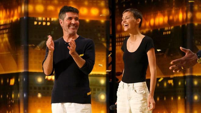 """America's Got Talent"" judge Simon Cowell, left, applauds artist Jane Marczewski after awarding her the Golden Buzzer on the show. (Photo by Trae Patton/NBC)"