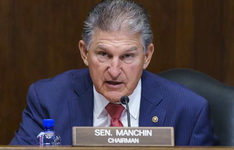Sen. Joe Manchin, D-W.Va., chair of the Senate Energy and Natural Resources Committee, presides over a confirmation hearing for presidential appointments, on Capitol Hill in Washington, Tuesday, May 18, 2021. With the Democrats in the Senate having a slim majority, the moderate Democrat and the crucial 50th vote for his party is playing the pivotal role in President Joe Biden's infrastructure plans. (AP Photo/J. Scott Applewhite)