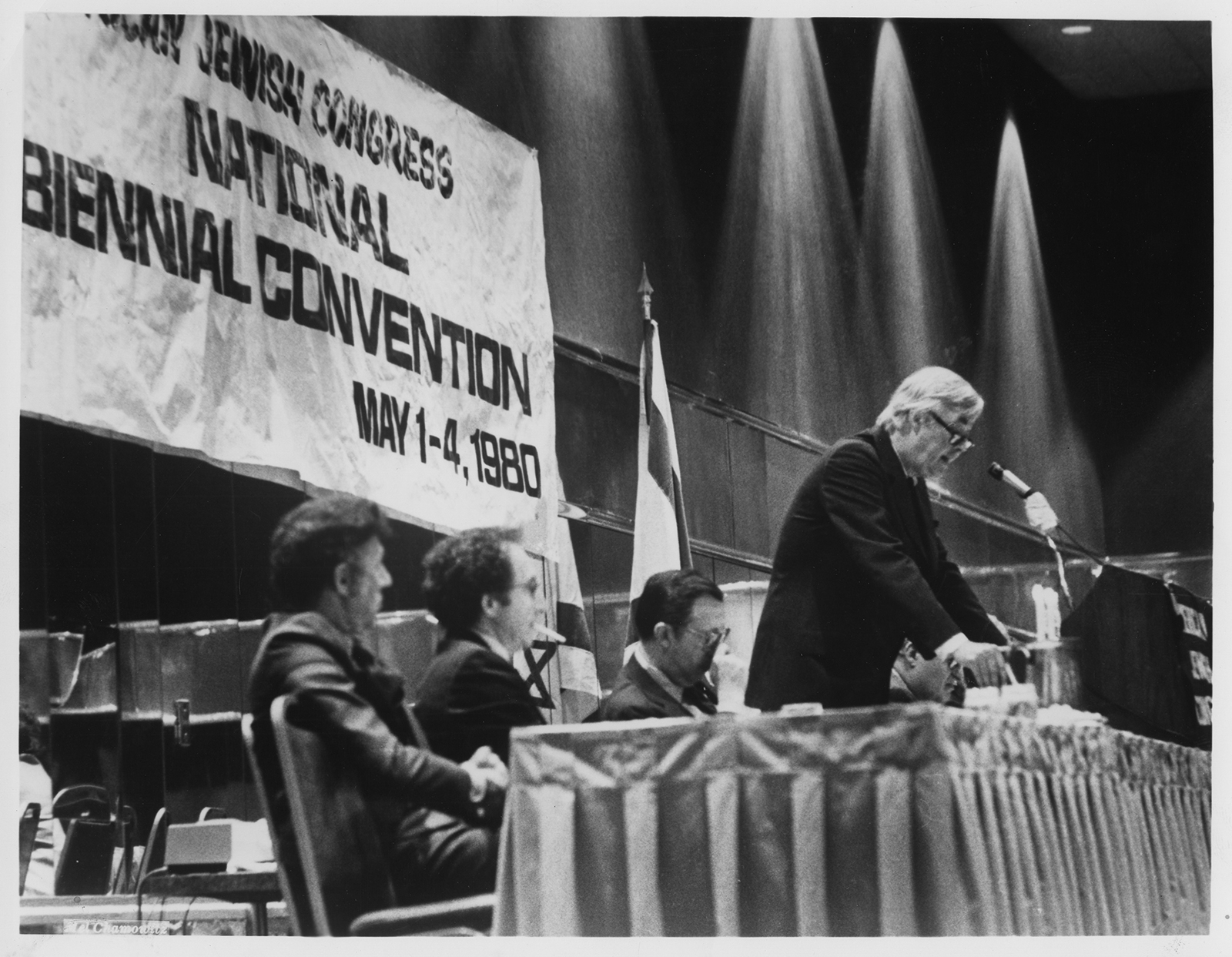 """Senator Daniel P. Moynihan (D-NY) addresses delegates to the American Jewish Congress national biennial convention in Washington in May 1980. With him, from left, are Phil Baum, associate executive director, Henry Siegman, executive director, and Howard M. Squadron, president. In a sobering speech to the Jewish leaders, Mr. Moynihan warned that """"the shift of military power away from the U.S. and toward the Soviet Union"""" is taking a heavy toll on American diplomacy, requiring """"painful and expensive approaches"""" to check Soviet expansionism in the Middle East and Southwest Asia."""" He declared, """"It is clear that in the aftermath of the Soviet invasion of Afghanistan the Administration began to look to a resolution of the Palestinian issue manifestly tilted against Israel, as a means of bolstering the American position in the region. RNS archive photo. Photo courtesy of the Presbyterian Historical Society."""
