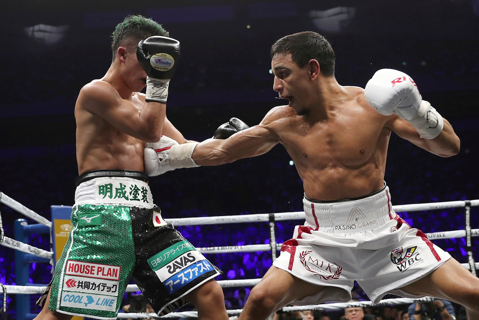 France's Nordine Oubaali, right, sends a right to Japan's Takuma Inoue in the sixth round of their WBC world bantamweight title match in Saitama, Japan, Thursday, Nov. 7, 2019. Oubaali defeated Inoue by a unanimous decision. (AP Photo/Toru Takahashi)