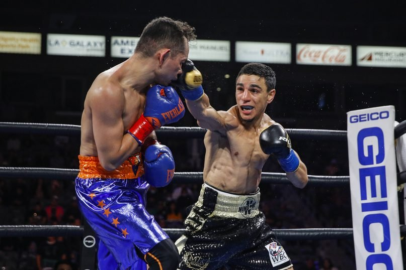 Nordine Oubaali, right, lands a punch on Nonito Donaire during a May 29, 2021, WBC Bantamweight title fight in Carson, California.  Donaire won the fight. Photo by Esther Lin/Showtime
