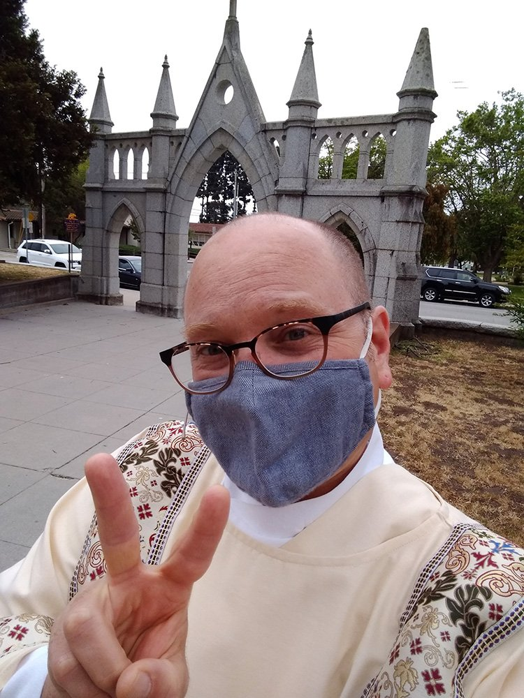 Deacon Joseph DePage takes a selfie while getting ready for the Solemnity of the Ascension at Holy Cross Catholic Church in Santa Cruz, California, on May 16, 2021. Photo by Joseph DePage
