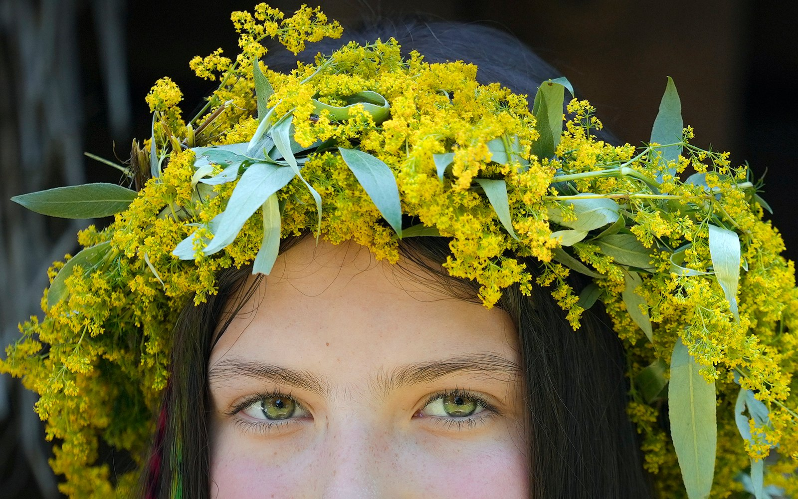 A young girl wearing a wreath of flowers takes part in an event inspired by pre-Christian traditions at the Dimitrie Gusti village museum in Bucharest, Romania on Thursday, June 24, 2021. According to pre-Christian traditions, fairies, called