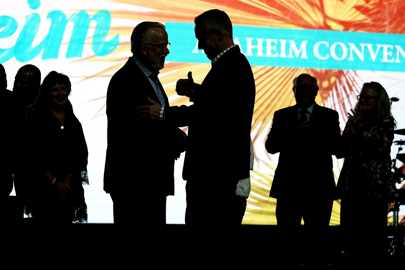 Incoming Southern Baptist Convention President Ed Litton, center left, talks with outgoing President J.D. Greear, center right, at the conclusion of the annual Southern Baptist Convention meeting, Wednesday, June 16, 2021, in Nashville, Tenn. (AP Photo/Mark Humphrey)