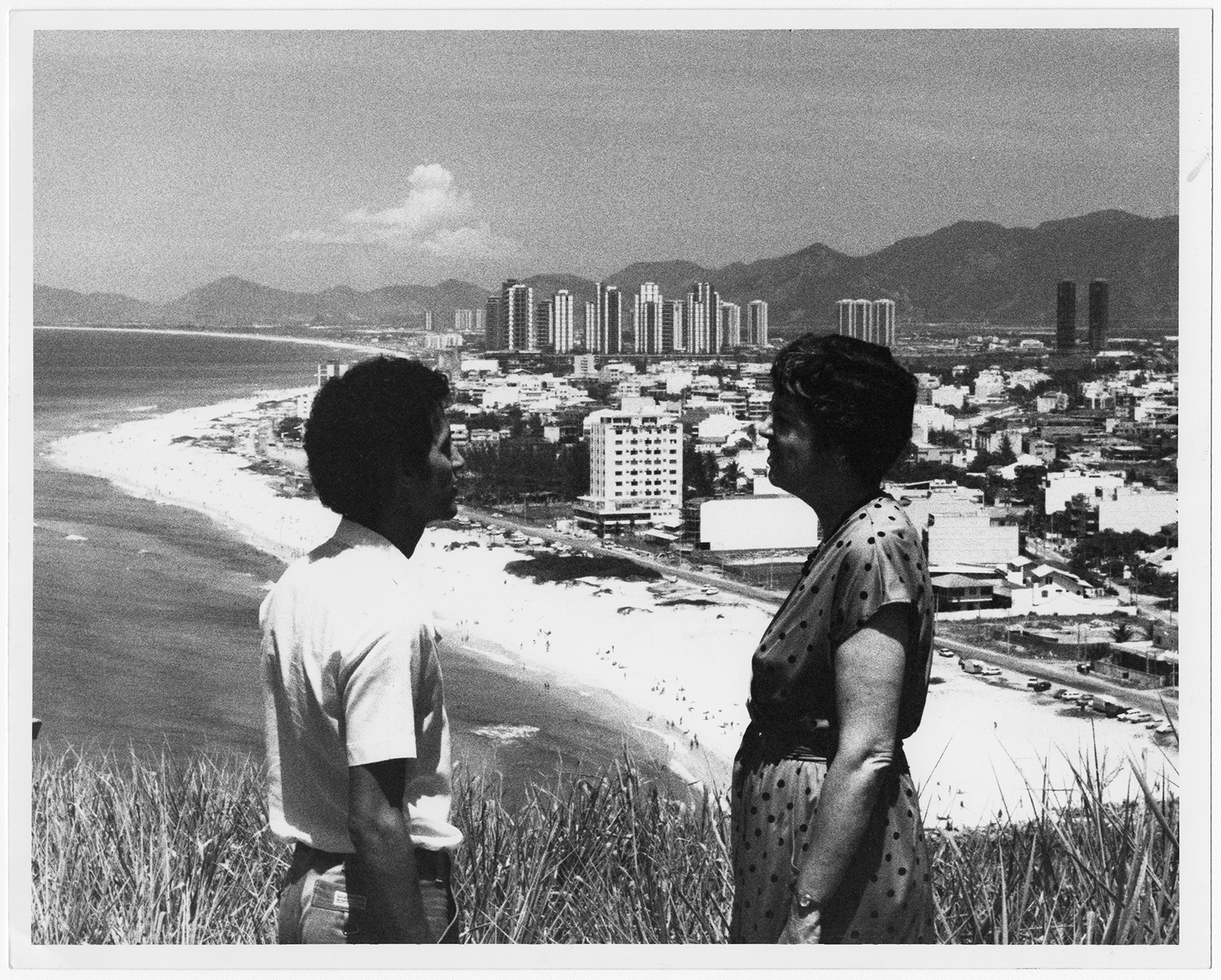 Brazilian seminary student Rui Cleber, left, and Southern Baptist missionary Elizabeth Oates stand on a hillside overlooking the Barra, a rapidly developing beachfront area where many of Rio de Janeiro's wealthiest people are seeking sanctuary from the city's traffic and noise, in 1980. Five Bible studies have been started, and plans are being made for a new church. RNS archive photo by Bob Harper. Photo courtesy of the Presbyterian Historical Society.