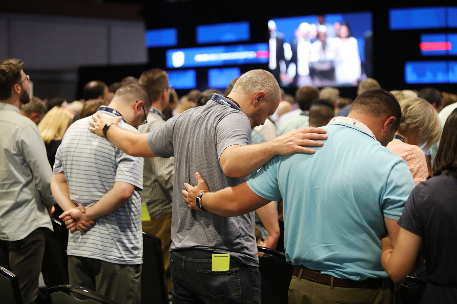 Messengers pray together during the annual meeting of the Southern Baptist Convention, Tuesday, June 15, 2021, at the Music City Center in Nashville. RNS photo by Kit Doyle