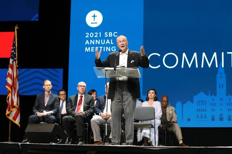 James Merritt, backed by members of the Committee on Resolutions, addresses the Southern Baptist Convention annual meeting June 15, 2021, in Nashville, Tennessee. RNS photo by Kit Doyle