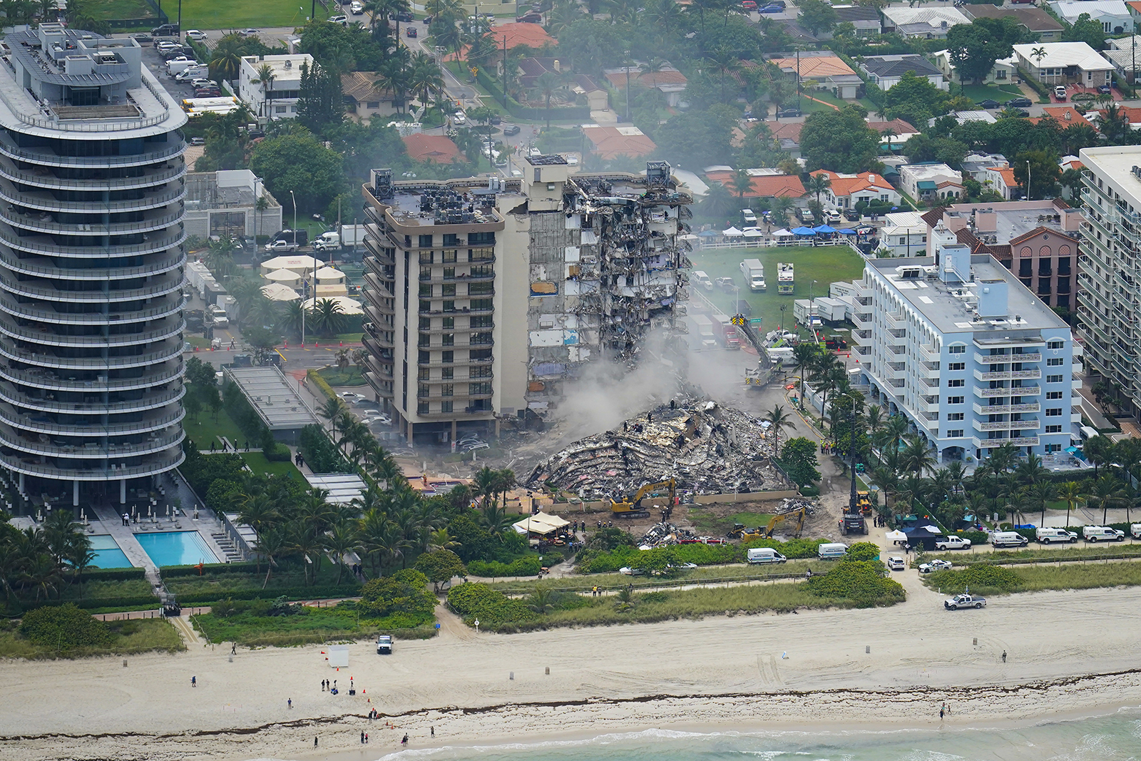 Rescue personnel work in the rubble at the Champlain Towers South, June 25, 2021, in Surfside, Florida. The seaside condominium building partially collapsed on June 24. (AP Photo/Gerald Herbert)