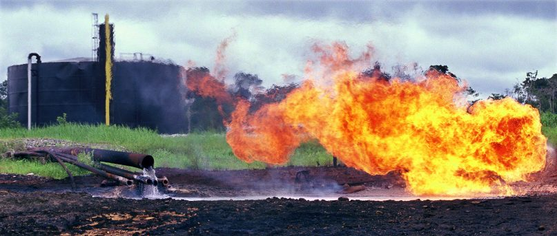 Oil waste pit fire at a facility built by Texaco, which is now under the Chevron umbrella, in Shushufindi, Ecuador, in 1993. Photo courtesy of Steven Donziger