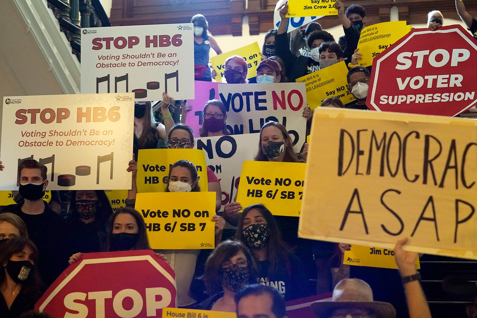 In this May 6, 2021, file photo, a group opposing new restrictive voter legislation gather outside the House Chamber at the Texas Capitol in Austin, Texas. (AP Photo/Eric Gay, File)