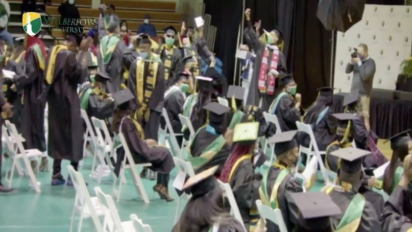 2021 Wilberforce University graduates celebrate after learning that school debts had been forgiven, May 29, 2021, in Wilberforce, Ohio. Video screen grab