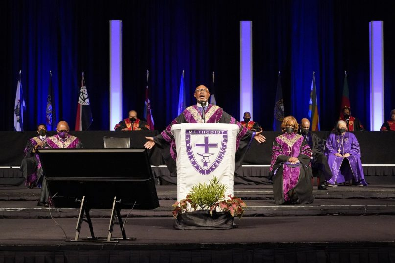 Bishop Wilfred T. Messiah, center, delivers an invocation during the opening worship service at the African Methodist Episcopal Church conference July 6, 2021, in Orlando, Florida. (AP Photo/John Raoux)