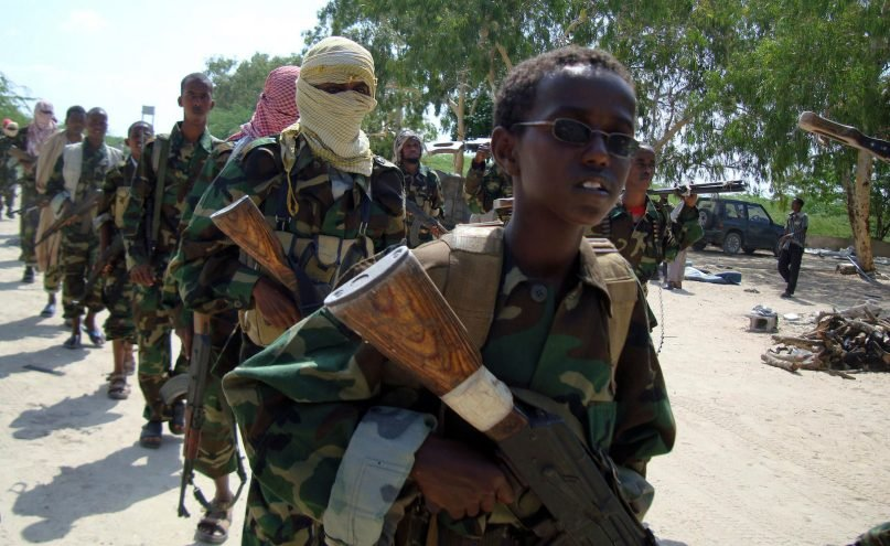 In January of 2010, a youth led a group of hard-line Islamist Al Shabab fighters on military exercises in Somalia. Faith groups have helped turned the tide of recruitment by the Islamic militant group in recent years. (AP Photo/ Farah Abdi Warsameh)