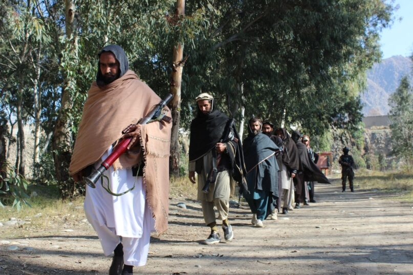 In early 2021, some Taliban fighters surrendered their weapons to support peace talks with the Afghan government. Today the Islamic extremist group is battling government forces to control the country.  (Xinhua/Emran Waak via Getty Images)