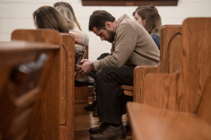 Young evangelical Christians are facing a dilemma whether to follow in the footsteps of their parents or pursue other choices. (Nicholas Kamm/AFP via Getty Images)