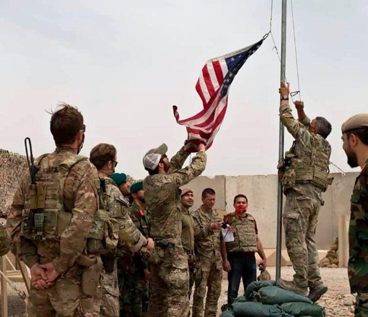 A handover ceremony in July 2021, as U.S. troops prepare to leave Afghanistan. (Afghan Ministry of Defense Press Office via AP)