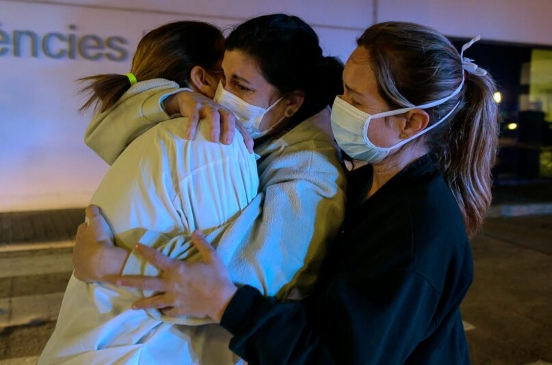Part of the joy of emerging from the pandemic has been to once again be able to hug friends and family. (Jose Jordan/AFP via Getty Images)