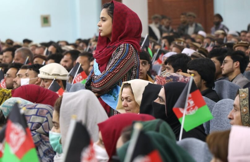 Afghan citizens at a March 2021 rally in Kabul to support peace talks between the Taliban and the government.  (Haroon Sabawoon/Anadolu Agency via Getty Images)