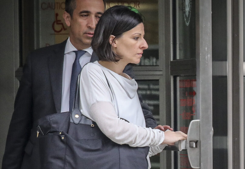 FILE - This Oct. 4, 2018 photo shows Lauren Salzman as she leaves Brooklyn Federal Court in New York. Salzman, a former member of NXIVM leader Keith Raniere's inner circle in his sex trafficking enterprise avoided prison at sentencing Wednesday, July 28, 2021 after prosecutors cited her extraordinary cooperation. (AP Photo/Bebeto Matthews, file)