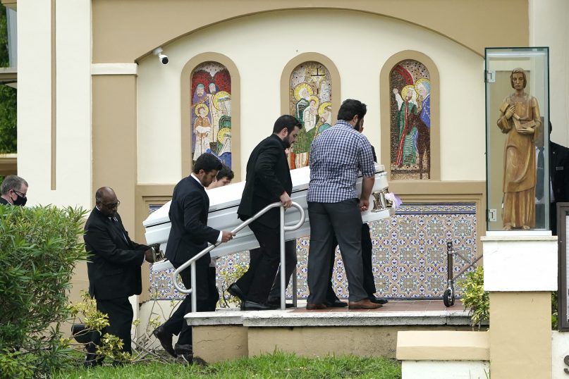 Pallbearers carry the casket of Marcus Guara's daughters before a funeral service for the family at St. Joseph Catholic Church, Tuesday, July 6, 2021, in Miami Beach, Fla. Guara, his wife Anaely, and daughters Lucia and Emma, died in the collapse of the Champlain Towers South condominium building in nearby Surfside. (AP Photo/Lynne Sladky)