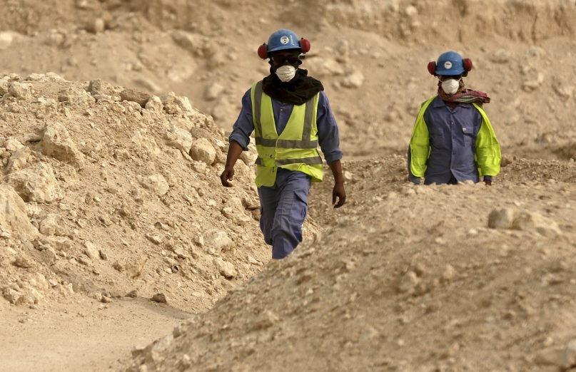 In this file photo taken during a government-organized media tour, workers walk back to the Al-Wakra Stadium worksite being built for the 2022 World Cup, in Doha, Qatar. (AP Photo/Maya Alleruzzo, File)