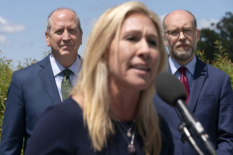 Rep. Marjorie Taylor Greene, R-Ga., center, speaks during a news conference May 12, 2021, with Rep. Dan Bishop, R-N.C., back left, and Russ Vought, president of the Center for Renewing America, as they express their opposition to critical race theory, on Capitol Hill in Washington. (AP Photo/Jacquelyn Martin)