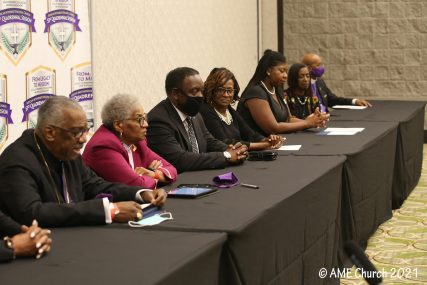 From left, Senior Bishop Adam J. Richardson, Jr., Bishop Anne Henning Byfield, Orlando Mayor Jerry L. Demings join together with other colleagues for a press conference during the 51st annual AME general conference. Photo courtesy of AME Church